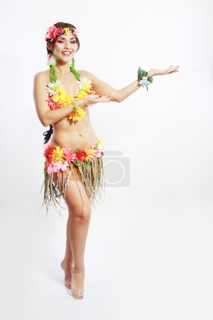 Photo for Beautiful exotic girl with Hawaiian accessories inviting and smiling - Royalty Free Image