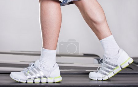Male legs in health club