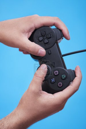 Photo for Play game with a joystick - Royalty Free Image