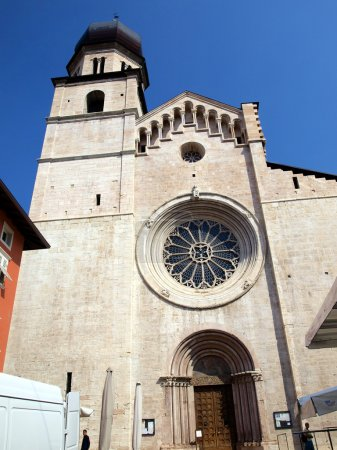 Cathedral of Trento, round window with ornate stained glass rose