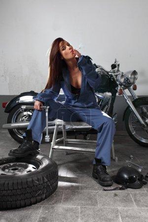 Sexy female motorcycle mechanic
