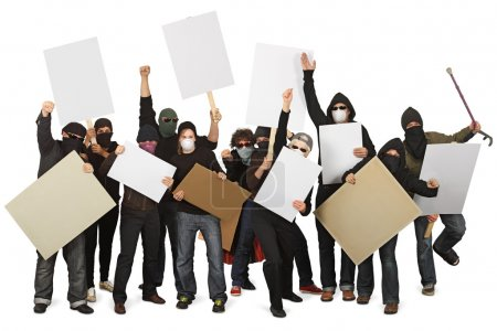 Photo for Photo of a group of unrecognizable protesters wearing masks and holdings signs. - Royalty Free Image