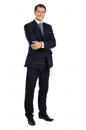 Attractive businessman standing with arms crossed