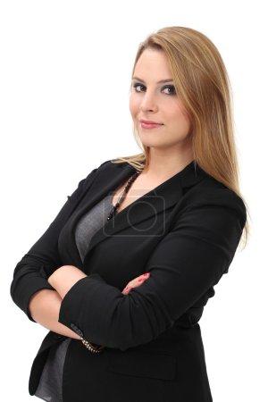 Photo pour Photo d'une jeune femme d'affaires blonde debout les bras croisés . - image libre de droit