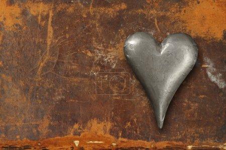 Metal heart on grunge background