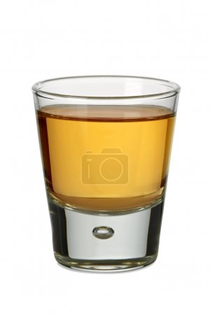 Photo for Photo of a shot glass filled with whiskey or bourbon. - Royalty Free Image