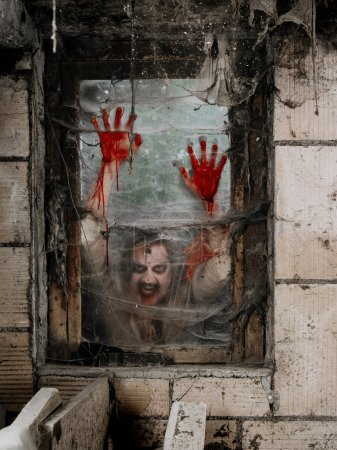 Hungry zombie at the window