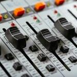 Macro photo of faders of a studio soundboard...