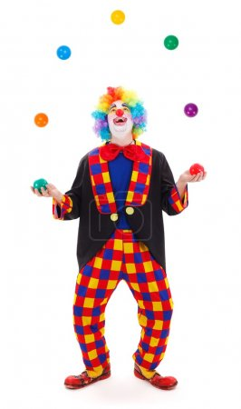 Funny clown juggling with colorful balls...