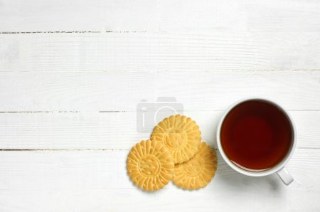 Photo for Background with cup of tea and cookies top view - Royalty Free Image