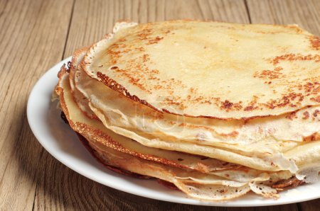 Stack of pancakes on wooden table closeup...