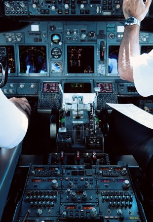 Airliner Cockpit with Pilots Working