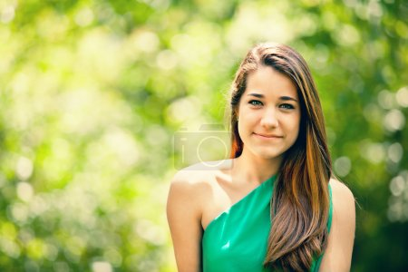 Photo for Beautiful Teenager Smiling in a Green Nataure Background - Royalty Free Image