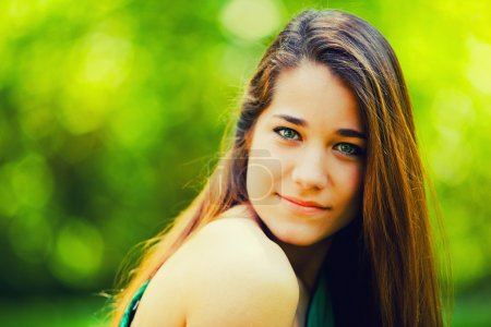 Photo for Beautiful Teenager Smiling in a Green Nature Background - Royalty Free Image