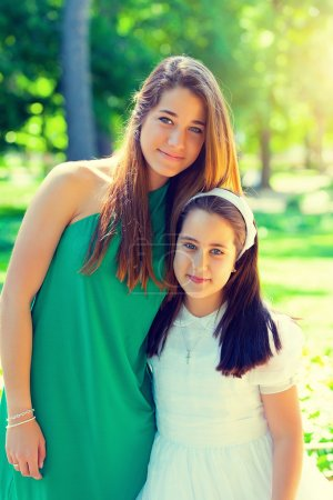 Photo for Two beautiful sisters in the First Communion Day - Royalty Free Image