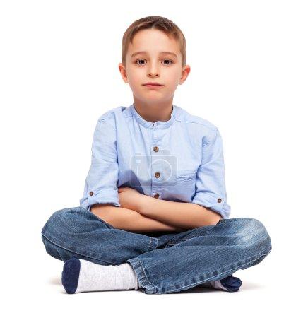 Little Boy Sitted on Floor