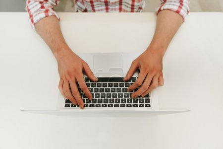 Photo for Hands Typing on a Modern Laptop - Royalty Free Image
