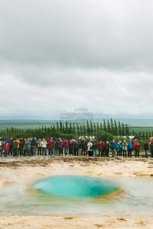 People Waiting for the Eruption of Strokkur Geyser