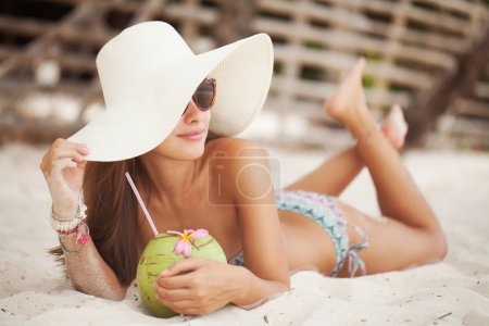 Beautiful woman with coconut