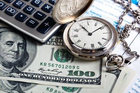 Money, clock and calculator