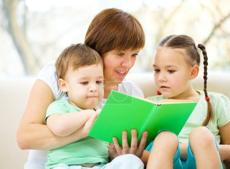 Family is reading book