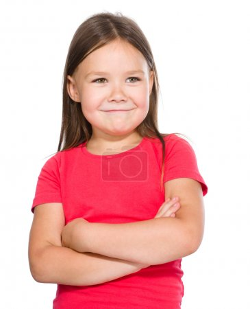 Photo for Portrait of a happy little girl in red t-shirt crossing her hands, isolated over white - Royalty Free Image