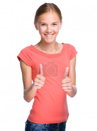 Young girl is showing thumb up gesture