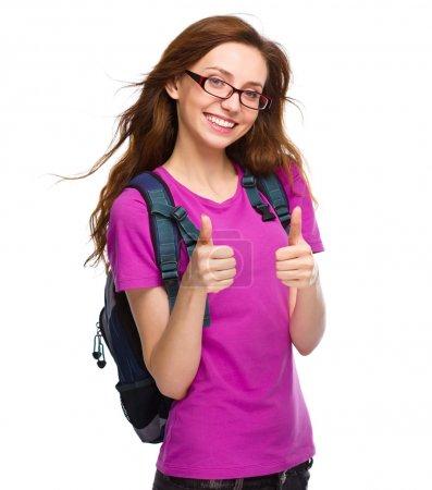 Photo pour Jeune fille étudiante montre pouce vers le haut signe à l'aide des deux mains, isolé sur blanc - image libre de droit