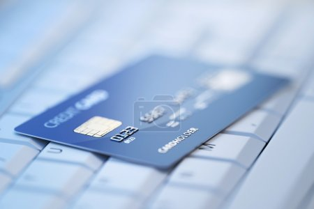 Credit card on computer keyboard