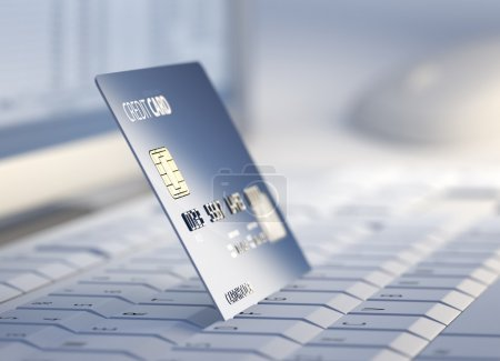 Credit card at desktop computer