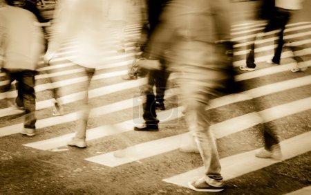 crowd on zebra crossing street