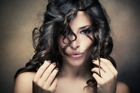 Photo for Sensual brunette woman with shiny curly silky hair - Royalty Free Image
