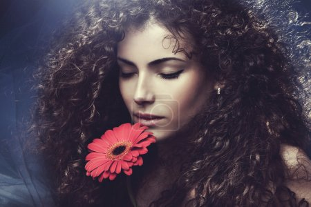 Photo for Curly hair young woman beauty portrait with flower - Royalty Free Image