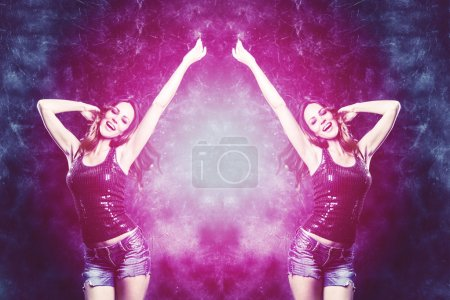 Photo for Dancing woman in purple and blue colors studio shot - Royalty Free Image