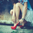 Woman legs in red high heel shoes and short skirt ...