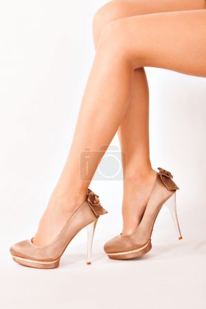 Photo for Woman legs in high heels side shot - Royalty Free Image