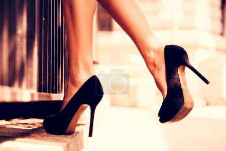 Photo for Woman legs in high heel shoes outdoor shot - Royalty Free Image