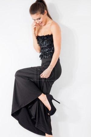 Photo for Woman in long black elegant dress studio shot - Royalty Free Image