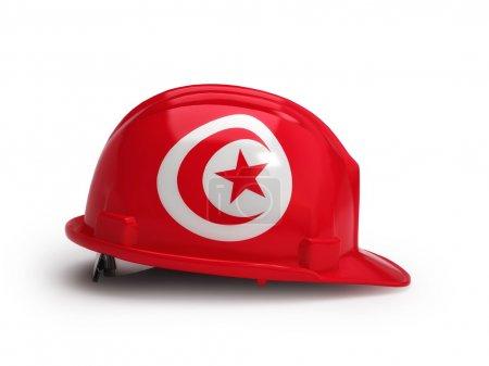 Photo pour Drapeau tunisien sur casque de construction isolé sur fond blanc - image libre de droit