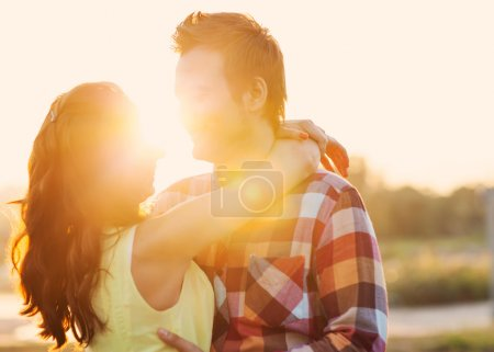 Photo for Young couple in love outdoor at sunset - Royalty Free Image