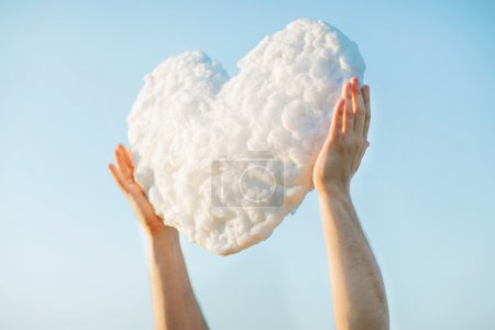 Young man get the heart - cloud to make proffer to his girlfrien