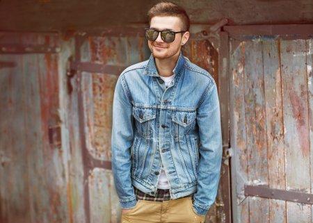 Fashion young man posing