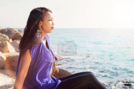 Photo for Gorgeous young lady relaxing near the water - Royalty Free Image