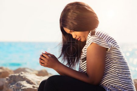 Photo for Young girl praying in nature by the Sea - Royalty Free Image