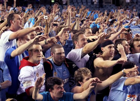 MELBOURNE - MARCH 20: Sydney FC fans celebrate their A-League grand final lwin over Melbourne Victory on March 20, 2010 in Melbourne.