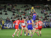 MELBOURNE - SEPTEMBER 12: Swans and bulldogs players in action in the AFL second semi final - Western Bulldogs vs Sydney Swans, September 2008