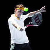 MELBOURNE - JANUARY 25: Roger Federer of Switzerland in his quarter final win over Stanislas Wawrinka of Switzerland in the 2011 Australian Open