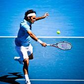 Melbourne, Austrálie - 25. ledna: roger federer v jeho vítězství nad lleyton hewitt během 2010 australian open