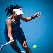 MELBOURNE, AUSTRALIA - JANUARY 26: Jie Zheng in action at her qu