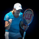MELBOURNE, AUSTRALIA - JANUARY 26: Justine Henin on her way to t